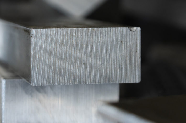 closeup of metal pieces that was cut square