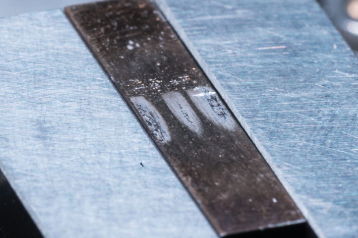 metal component with marks from friction wear testing