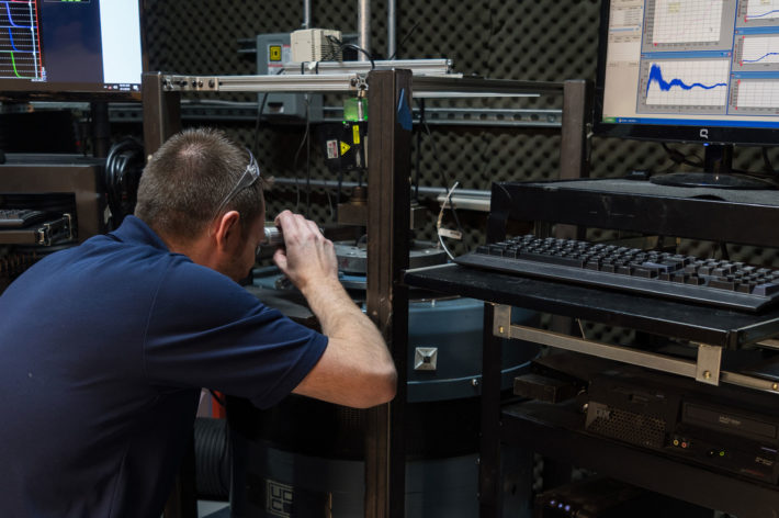 man in navy blue shirt performing vibration test