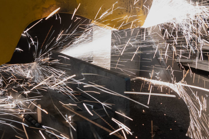 metal being cut with sparks flying