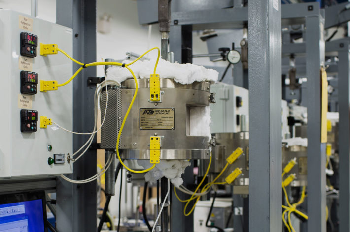 intricate machine shop with yellow wire