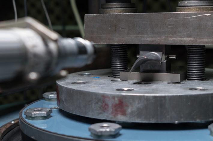 closeup of vibration testing on metal fasteners